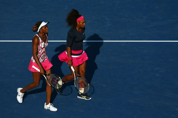 NEW YORK, NY - AUGUST 31:  Serena Williams of the United States walks next to her partner Venus Williams of the United States during their women's doubles second round match against Kristina Mladenovic of France and Klaudia Jans-Ignacik of Poland on Day F