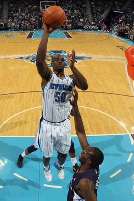 NEW ORLEANS, LA - JANUARY 18:  Emeka Okafor #50 of the New Orleans Hornsets shoots the ball over Quincy Pondexter #20 of the Memphis Grizzlies at New Orleans Arena on January 18, 2012 in New Orleans, Louisiana.  NOTE TO USER: User expressly acknowledges a