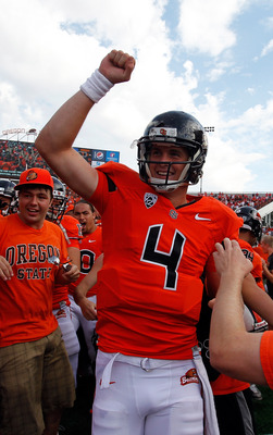 CORVALLIS, OR - SEPTEMBER 08:  Quarterback Sean Mannion #4 of the Oregon State Beavers celebrates with fans after defeating the Wisconsin Badgers 10-7 on September 8, 2012 at the Reser Stadium in Corvallis, Oregon.  (Photo by Jonathan Ferrey/Getty Images)