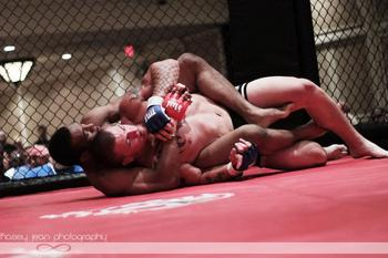 Clarence Jordan looks for a rear-naked choke. (Photo: Kasey Noll Kasey Jean Photography)