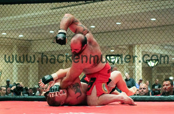 Matt Larson hammers down onto Brad Scholten. (Photo: Sandy Hackenmueller, Fight to Finish Photography)