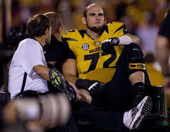 Missouri All-America candidate Elvis Fisher is carted off the field after an MCL injury.  Photo by Shane Keyser / Kansas City Star