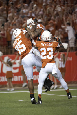Sep 8, 2012; Austin, TX, USA; Texas Longhorns linebacker Kendall Thompson (35) and safety Kenny Vaccaro (4) and corner back Carrington Byndom (23) react after a fumble recovery against the New Mexico Lobos during the second half at Darrell K Royal-Texas M