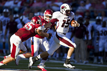 LITTLE ROCK, AR - SEPTEMBER 8:   Kolton Browning #15 of the Louisiana-Monroe Warhawks runs the ball against the Arkansas Razorbacks at War Memorial Stadium on September 8, 2012 in Little Rock, Arkansas.  The Warhawks defeated the Razorbacks 34-31.  (Photo