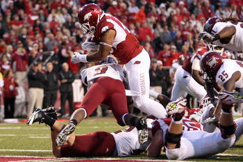 Kody Walker scores a touchdown last year against Troy.