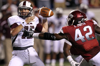 Chris Smith, right, tries to make a sack against Louisiana-Monroe.