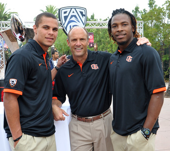 Jordan Poyer, Mike Riley and Markus Wheaton