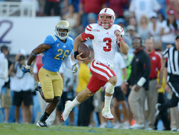 Sep 8, 2012; Pasadena, CA, USA; Nebraska Cornhuskers quarterback Taylor Martinez (3) is pursued by UCLA Bruins safety Andrew Abbott (26) on a 92-yard touchdown run at the Rose Bowl. Mandatory Credit: Kirby Lee/Image of Sport-US PRESSWIRE