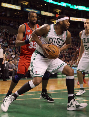 BOSTON, MA - MARCH 02: Chris Wilcox #44 of the Boston Celtics heads to the net as Shelden Williams #33 of the New Jersey Nets defends on March 2, 2012 at TD Garden in Boston, Massachusetts. NOTE TO USER: User expressly acknowledges and agrees that, by dow