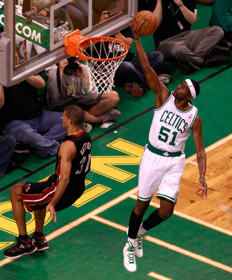 BOSTON, MA - JUNE 01:  Keyon Dooling #51 of the Boston Celtics drives for a shot attempt in the first quarter against Shane Battier #31 of the Miami Heat in Game Three of the Eastern Conference Finals in the 2012 NBA Playoffs on June 1, 2012 at TD Garden