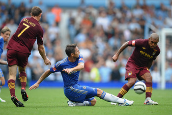 Frank Lampard applying a tackle