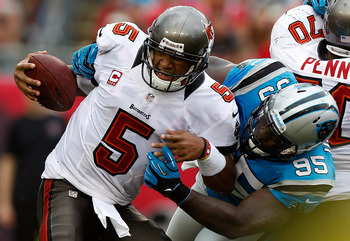Charles Johnson (95) was in on one of the Panthers' two sacks against Josh Freeman and the Bucs.