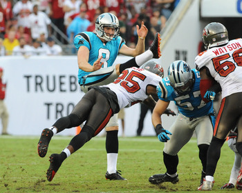 Brad Nortman's (8) punt was blocked by the Bucs' Aqib Talib.