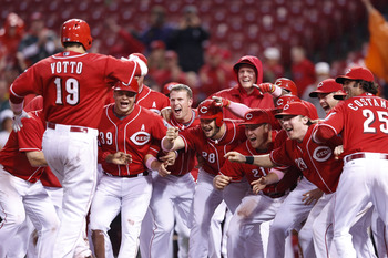Votto and the Reds celebrate a May win over the Washington Nationals. The win will mean a lot more if it comes in the postseason.