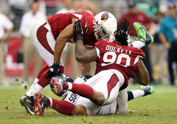 Darnell Dockett will look to bring down Tom Brady.
