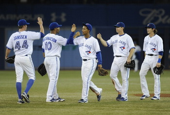 TORONTO, CANADA - SEPTEMBER 5:  Casey Janssen #44, Edwin Encarnacion #10, Adeiny Hechavarria #3, Kelly Johnson #2 and Colby Rasmus #28 of the Toronto Blue Jays celebrate the team's win over the Baltimore Orioles during MLB game action September 5, 2012 at