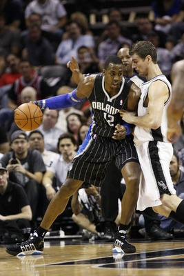Mar 14, 2012; San Antonio, TX, USA; Orlando Magic center Dwight Howard (12) posts up against San Antonio Spurs forward Tiago Splitter (right) during the first half at the AT&T Center. Mandatory Credit: Soobum Im-US PRESSWIRE