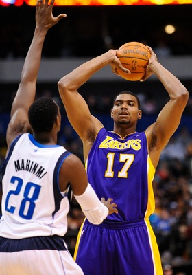 Mar 21, 2012; Dallas, TX, USA; Los Angeles Lakers center Andrew Bynum (17) looks to pass the ball over Dallas Mavericks center Ian Mahinmi (28) during the game at the American Airlines Center. The Lakers defeated the Mavericks 109-93. Mandatory Credit: Je