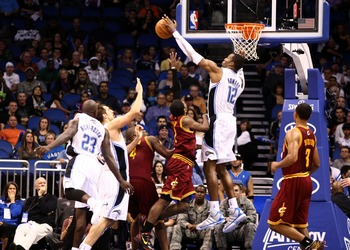 Feb 3, 2012; Orlando, FL, USA; Orlando Magic center Dwight Howard (12) blocks a layup by Cleveland Cavaliers point guard Kyrie Irving (2) during the fourth quarter at Amway Center. Orlando defeated Cleveland 102-94. Mandatory Credit: Douglas Jones-US PRES