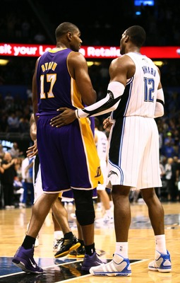 Jan 20, 2012; Orlando, FL, USA; Los Angeles Lakers center Andrew Bynum (17) and Orlando Magic center Dwight Howard (12) shake hands after the game  at Amway Center. Orlando defeated Los Angeles 92-80. Mandatory Credit: Douglas Jones-US PRESSWIRE