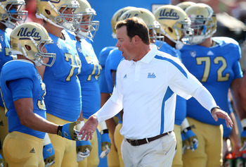 Jim Mora greeting his team