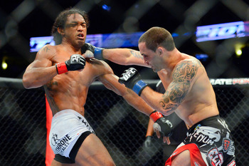 August 11, 2012; Denver, CO, USA; Benson Henderson (left) fights Frankie Edgar (right) during UFC 150 at the Pepsi Center. Mandatory Credit: Ron Chenoy-US PRESSWIRE