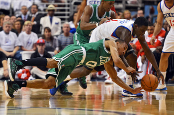 PHILADELPHIA, PA - MAY 18: Avery Bradley #0 of the Boston Celtics and Jrue Holiday #11 of the Philadelphia 76ers scramble for a loose ball in Game Four of the Eastern Conference Semifinals in the 2012 NBA Playoffs at the Wells Fargo Center on May 18, 2012