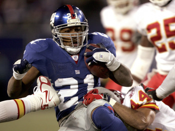 Tiki Barber out-dueled Larry Johnson in this 2005 Saturday afternoon affair by shredding the Chiefs in a game with playoff implications for both teams