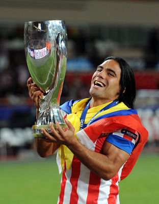 MONACO - AUGUST 31: Falcao of Atletico Madrid celebrates with the UEFA Super Cup following the match between Chelsea and Atletico Madrid at Louis II Stadium on August 31, 2012 in Monaco, Monaco. (Photo by Chris Brunskill/Getty Images)