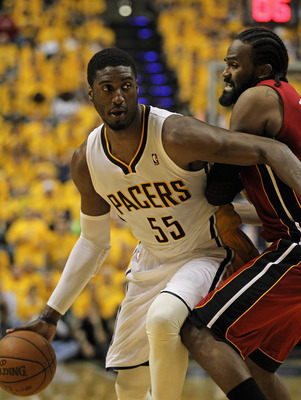 INDIANAPOLIS, IN - MAY 17: Roy Hibbert #55 of the Indiana Pacers moves against Ronny Turiaf #21 of the Miami Heat in Game Three of the Eastern Conference Semifinals in the 2012 NBA Playoffs at Bankers Life Fieldhouse on May 17, 2012 in Indianapolis, India