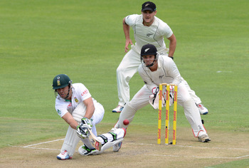 PORT ELIZABETH, SOUTH AFRICA - JANUARY 11:  AB de Villiers of South Africa sweeps a delivery during day 1 of the 2nd Test match between South Africa and New Zealand at Axxess St Georges on January 11, 2013 in Port Elizabeth, South Africa (Photo by Duif du