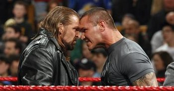 http://www.allwrestlingsuperstars.com/wp-content/uploads/2011/07/WWE-Superstars-Triple-H-and-Randy-Orton.jpg