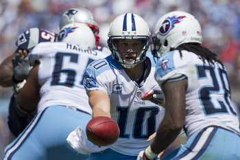NASHVILLE, TN - SEPTEMBER 9:   Jake Locker #10 makes a hand off to Chris Johnson #28 of the Tennessee Titans during the season opener against the New England Patriots at LP Field on September 8, 2012 in Nashville, Tennessee.  The Patriots defeated the Tit