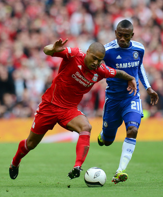 LONDON, ENGLAND - MAY 05:  Glen Johnson of Liverpool and Salomon Kalou of Chelsea battle for the ball during the FA Cup with Budweiser Final match between Liverpool and Chelsea at Wembley Stadium on May 5, 2012 in London, England.  (Photo by Shaun Botteri