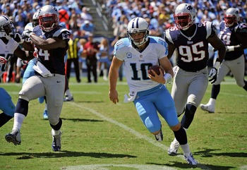 Dont'a Hightower and Chandler Jones chase down Titans' quarterback Jake Locker.
