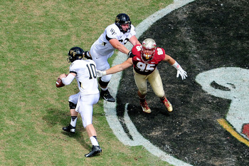 TALLAHASSEE, FL - SEPTEMBER 15:  Tanner Price #10 of the Wake Forest Demon Deacons is pressured by Bjoern Werner #95 of the Florida State Seminoles during a game at Doak Campbell Stadium on September 15, 2012 in Tallahassee, Florida.  (Photo by Stacy Reve
