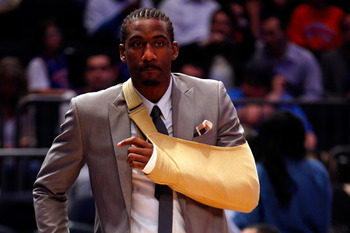Amar'e is sporting the new arm sling from Hugo Boss.