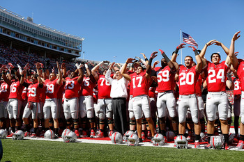 COLUMBUS, OH - SEPTEMBER 8:  Head Coach Urban Meyer of the Ohio State Buckeyes sings 'Carmen Ohio' with his players after defeating the Central Florida Knights 36-10 for his second straight win with Ohio State on September 8, 2012 at Ohio Stadium in Colum