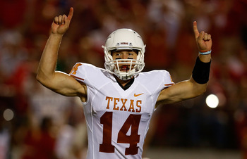 OXFORD, MS - SEPTEMBER 15:  David Ash #14 of the Texas Longhorns celebrates after a first half touchdown during the game against the Ole Miss Rebels at Vaught-Hemingway Stadium on September 15, 2012 in Oxford, Mississippi.  (Photo by Scott Halleran/Getty