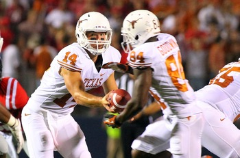 Sept 15, 2012; Oxford, MS, USA;   Texas Longhorns quarterback David Ash (14) prepares to hand off the ball to wide receiver Marquise Goodwin (84) during the game against the Mississippi Rebels.  Mandatory Credit: Spruce Derden�US PRESSWIRE