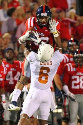 Sept 15, 2012; Oxford, MS, USA;   Mississippi Rebels wide receiver Donte Moncrief (12) receives a pass against Texas Longhorns cornerback Quandre Diggs (6) during the game at Vaught Hemingway Stadium.  Mandatory Credit: Spruce Derden�US PRESSWIRE