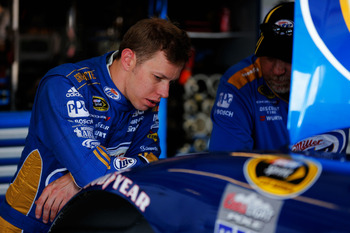 JOLIET, IL - SEPTEMBER 14:  Brad Keselowski, driver of the #2 Miller Lite Dodge, looks on in the garage during practice for the NASCAR Sprint Cup Series GEICO 400 at Chicagoland Speedway on September 14, 2012 in Joliet, Illinois.  (Photo by Justin Edmonds