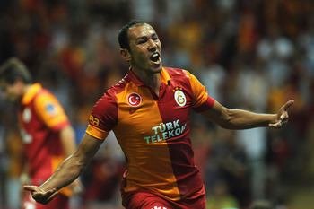 ISTANBUL, TURKEY - AUGUST 20:  Umut Bulut of Galatasaray AS celebrates after scoring the opening goal during the turkish Super League match between Galatasaray AS and Kimpasa AS at Turk Telekom Arena on August 20, 2012 in Istanbul, Turkey.  (Photo by Vale