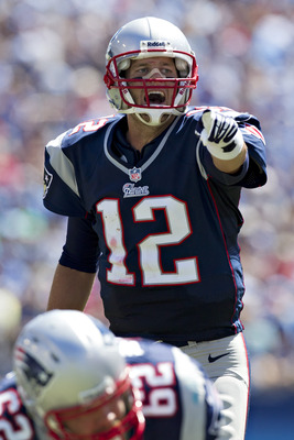 NASHVILLE, TN - SEPTEMBER 9:   Tom Brady #12 of the New England Patriots points to a blocking assignment  against the Tennessee Titans during their season opener at LP Field on September 8, 2012 in Nashville, Tennessee.  (Photo by Wesley Hitt/Getty Images