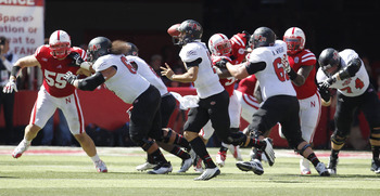 Sep 15, 2012; Lincoln, NE, USA; Arkansas State Red Wolves quarterback Ryan Aplin (16) looks to pass against the Nebraska Cornhuskers at Memorial Stadium in the first half. Mandatory Credit: Bruce Thorson-US PRESSWIRE