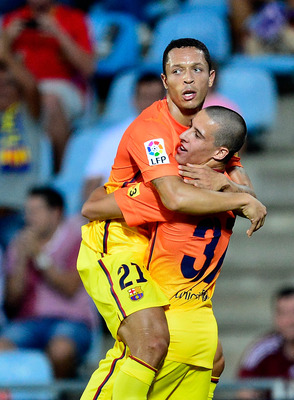 Adriano and Tello celebrate.