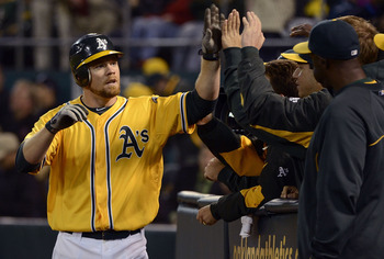 Brandon Moss high fives his teammates