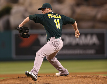 Jarrod Parker delivers the pitch