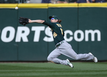 Josh Reddick dives for a ball in the outfield
