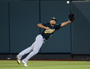 Coco Crisp leaves his feet for a ball hit deep into the outfield